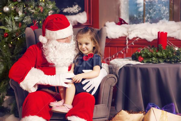 Little girl telling her Christmas wish in Santa Claus Stock photo © dashapetrenko
