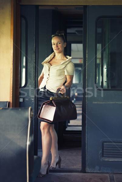 Woman with a suitcase in the retro train Stock photo © dashapetrenko