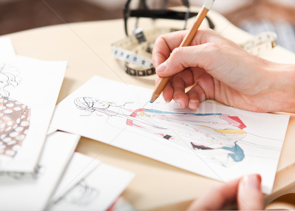 Dressmaker is drawing a fashion sketch Stock photo © dashapetrenko
