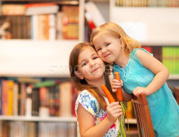 Küçük gülen kızlar havuç portre çiçek Stok fotoğraf © dashapetrenko