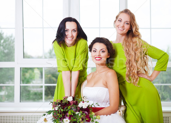 Cheerful bride with bridesmaid holding bouquet Stock photo © dashapetrenko