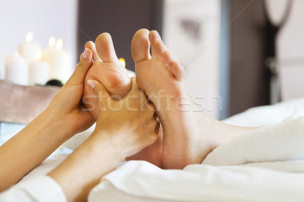 Massage of human foot in spa salon Stock photo © dashapetrenko