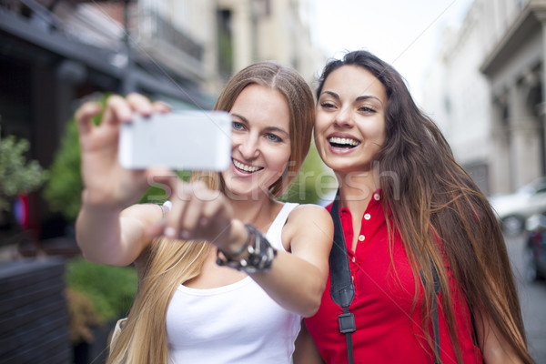 Stock photo: Close up lifestyle portrait of girls best friends makes funny gr