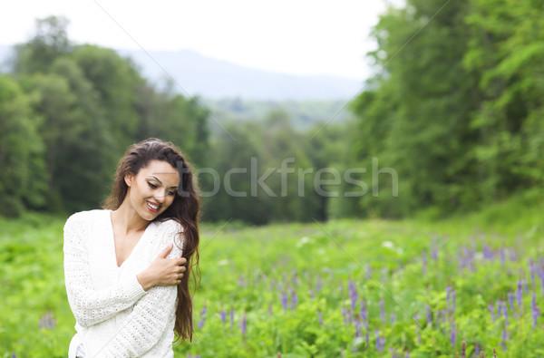 Happy pretty brunette woman in flower field Stock photo © dashapetrenko