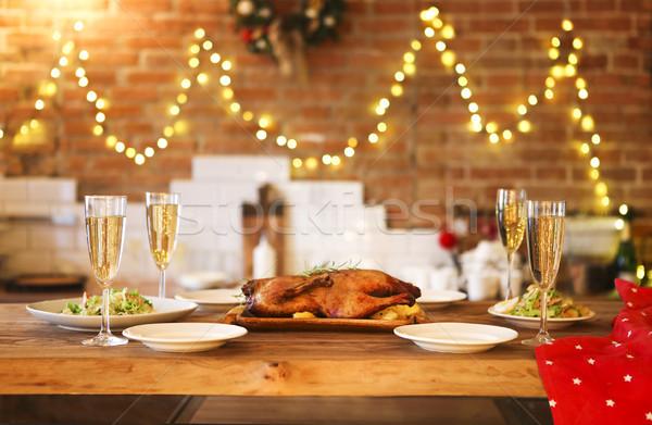 Karácsony vacsora kacsa pezsgő fa asztal háttér Stock fotó © dashapetrenko