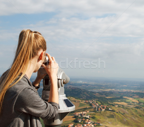Pretty blond woman looking at the scope Stock photo © dashapetrenko