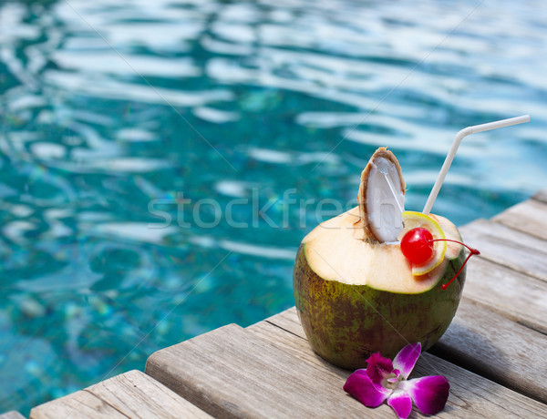 Coconut cocktail with drinking straw  Stock photo © dashapetrenko