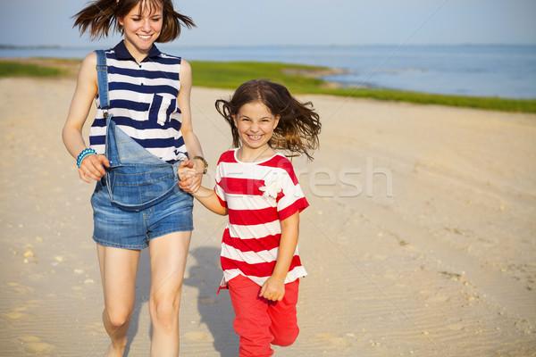Happy sister playing on beach  Stock photo © dashapetrenko