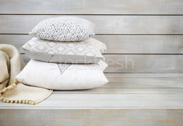 Cozy pillows and plaid on the light wooden background Stock photo © dashapetrenko