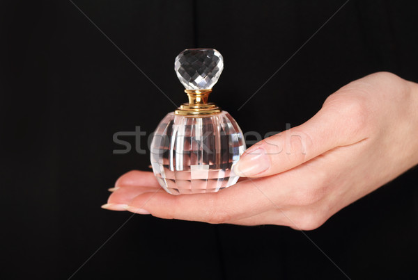 Vintage perfume garrafa mulher mão Foto stock © dashapetrenko