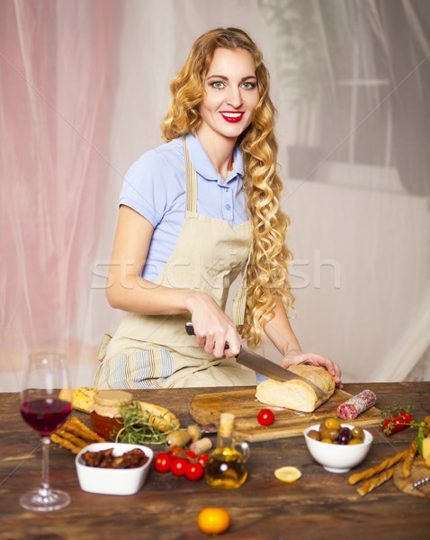 Happy woman cooking at the kitchen Stock photo © dashapetrenko