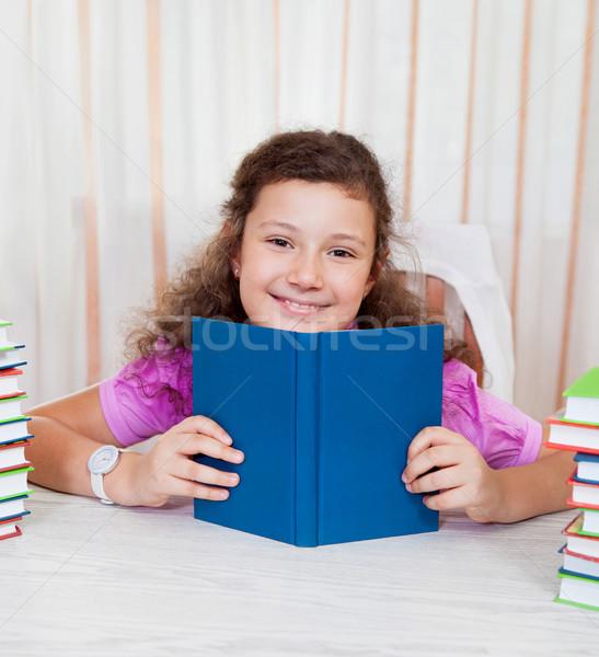 Little girl with piles of books Stock photo © dashapetrenko