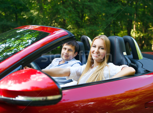 Happy couple in red cabriolet  Stock photo © dashapetrenko