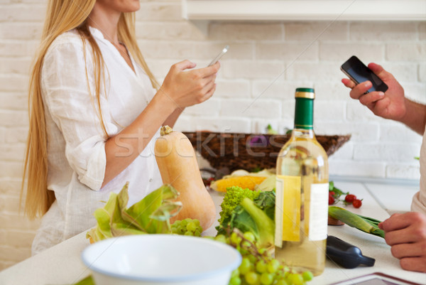 Couple cutting vegetables at the kitchen. Couple preparing dinin Stock photo © dashapetrenko