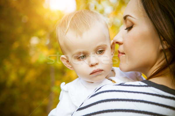 Mother with her baby daughter in autumn park Stock photo © dashapetrenko