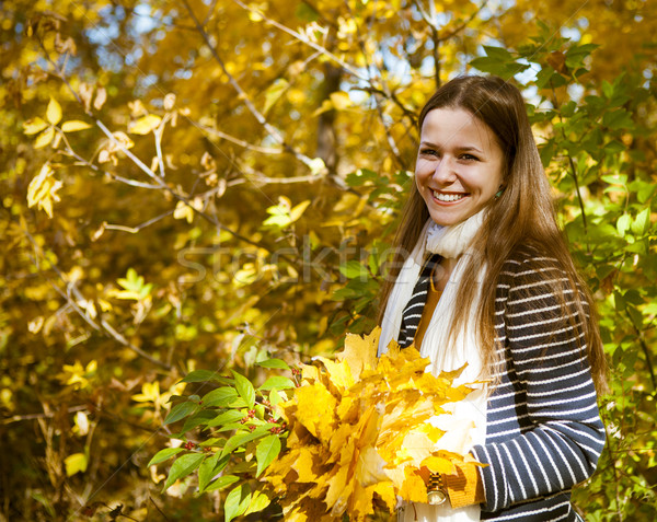 Portrait of a beautiful teenage girl having fun in autumn park Stock photo © dashapetrenko