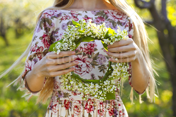 Young woman holding wreath from lily of the valley Stock photo © dashapetrenko
