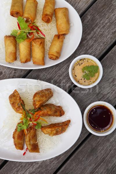 Chinese traditional spring rolls and gyoza or dumpling Stock photo © dashapetrenko