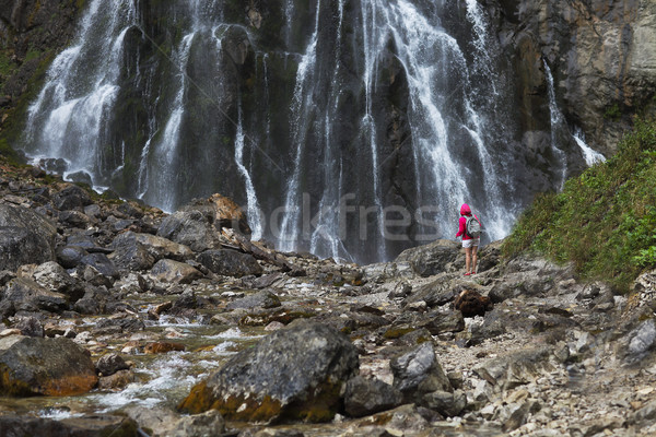 Young pretty tourist girl with backpack near waterfall Stock photo © dashapetrenko