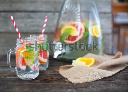 Glass of natural homemade lemonade by the jar  Stock photo © dashapetrenko