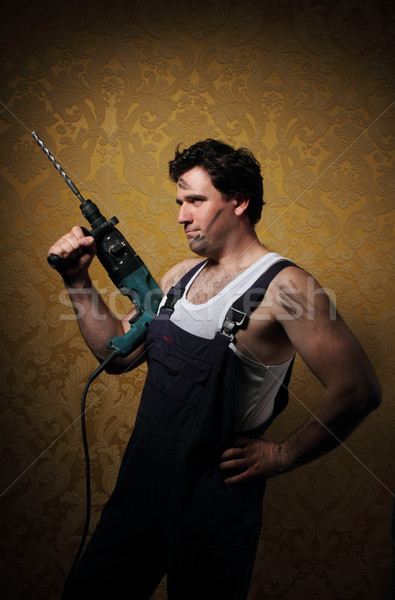 Builder with professional puncher-hammer  Stock photo © dashapetrenko