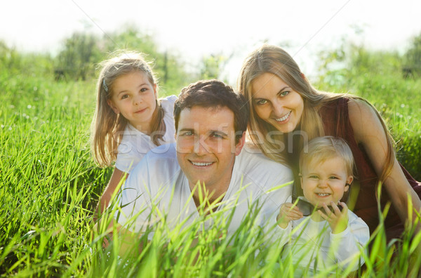 Happy young family with children Stock photo © dashapetrenko