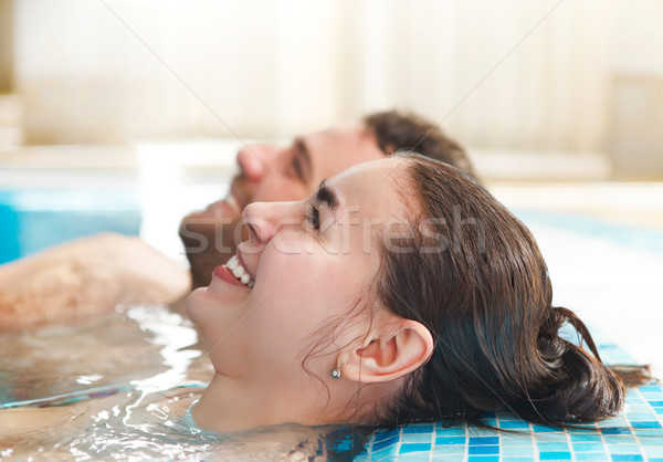 Young couple relaxing in water in a spa resort Stock photo © dashapetrenko
