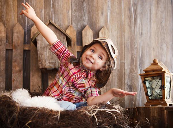 Boldog gyerek játszik pilóta sisak fából készült Stock fotó © dashapetrenko
