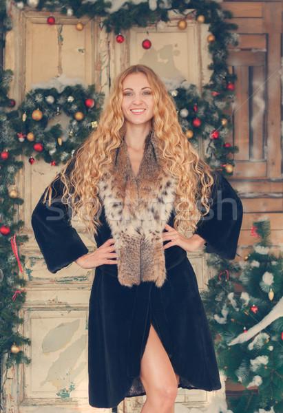 Portrait of the beautiful happy woman in furcoat  Stock photo © dashapetrenko