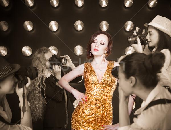 Superstar woman posing to paparazzi Stock photo © dashapetrenko