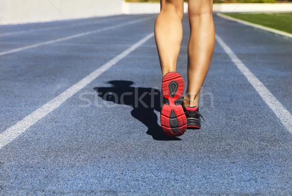 Atleta corredor pies abajo estadio tema Foto stock © dashapetrenko