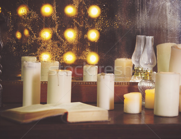 Many burning candles on a mirrored background Stock photo © dashapetrenko