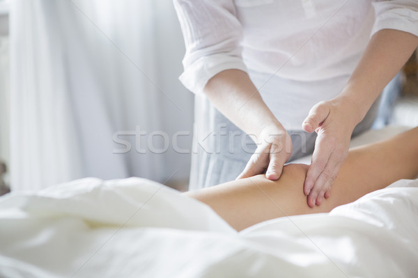 Foot massage treatment in asian spa salon Stock photo © dashapetrenko