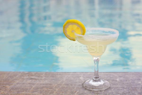 Cocktail glass on outdoor poolside Stock photo © dashapetrenko