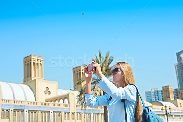 Woman taking mobile photo of the Central Souq in Sharjah City, U Stock photo © dashapetrenko