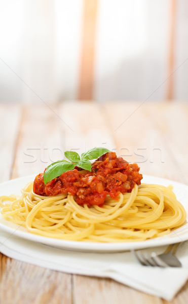 Spaghetti Bolognese on white plate Stock photo © dashapetrenko