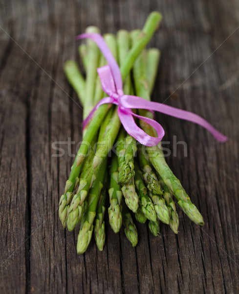 Bunch of fresh green asparagus spears tied with ribbon  Stock photo © dashapetrenko