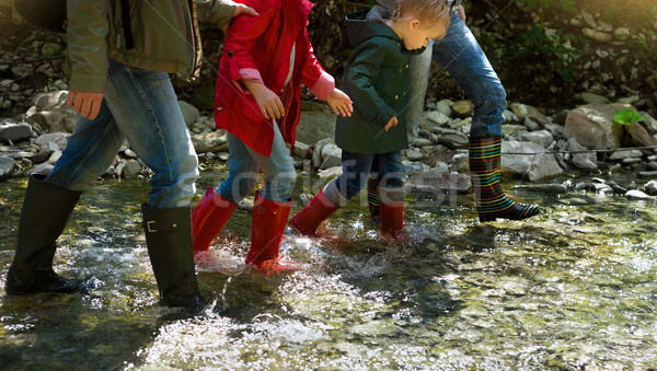 Young family with two little daughters on mountain trek Stock photo © dashapetrenko