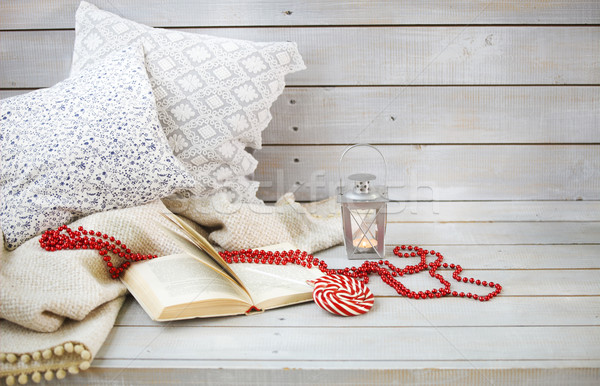 Still life with lantern, candy, book and red beads  Stock photo © dashapetrenko