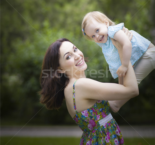 Beautiful young mother with daughter in summer park Stock photo © dashapetrenko