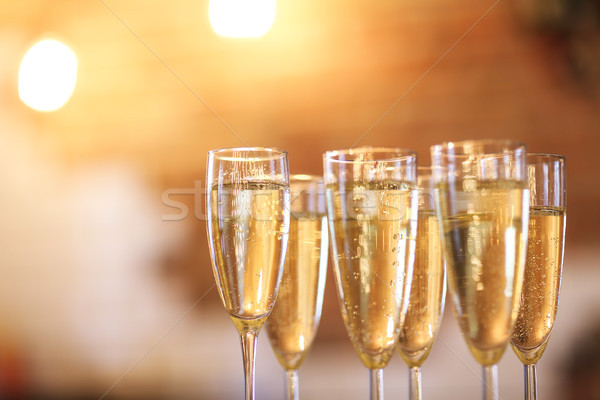 Champagne glasses on gold background. Party concept Stock photo © dashapetrenko
