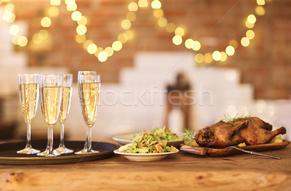 Winter holiday family dinner with roast poultry and champagne Stock photo © dashapetrenko