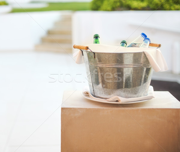 Ice bucket with mineral water outdoors Stock photo © dashapetrenko