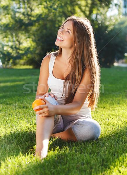 美しい 若い女の子 リラックス 夏 公園 緑の草 ストックフォト © dashapetrenko