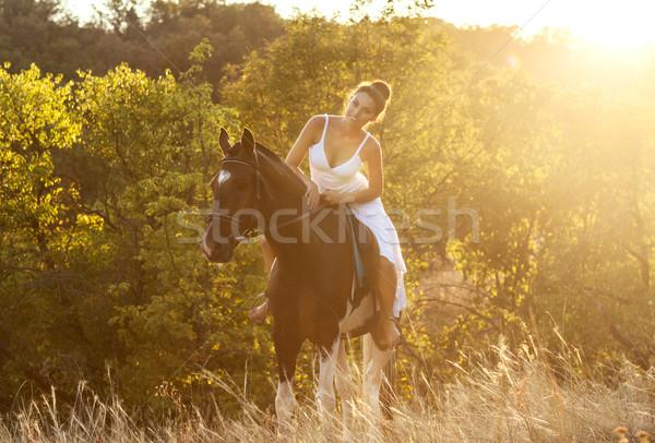 Bela mulher cavalo cavalo mulher céu madeira Foto stock © dashapetrenko