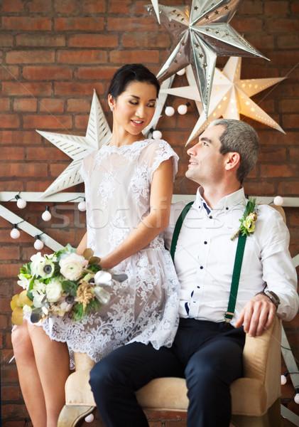 Cheerful married couple near the brick wall Stock photo © dashapetrenko