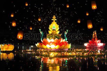 Big and small boats with candles and flowers are given for Thail Stock photo © dashapetrenko