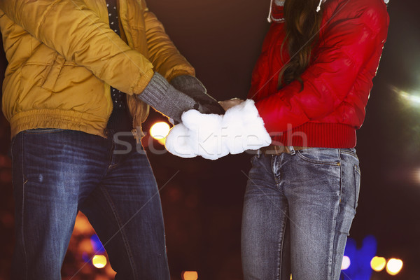 Happy couple holding hands in knitted mittens Stock photo © dashapetrenko