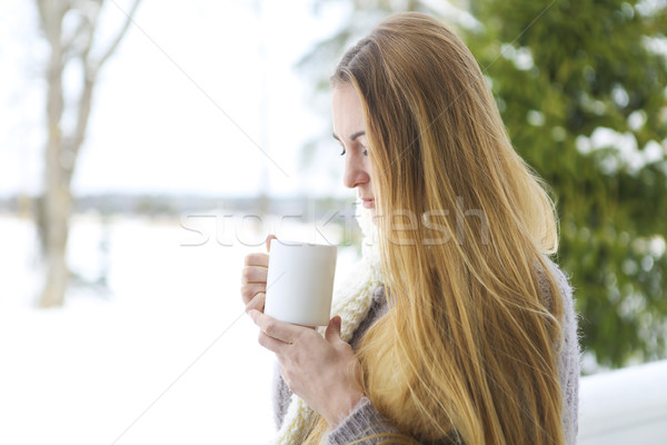 Young beautiful woman with blond hair outdoor with cup Stock photo © dashapetrenko