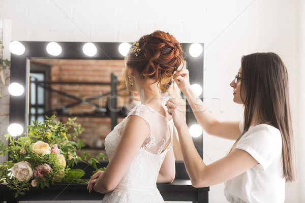 Young pretty bride and stylist in studio before wedding ceremony Stock photo © dashapetrenko
